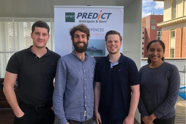 Staff in front of a PREDICT banner